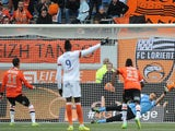 Lorient French forward Jeremie Aliadiere (L) scores a penalty kick during the French L1 football match Lorient vs Montpellier on April 20, 2014