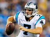 Jimmy Clausen #7 of the Carolina Panthers in action against Pittsburgh Steelers during a preseason NFL game on August 29, 2013