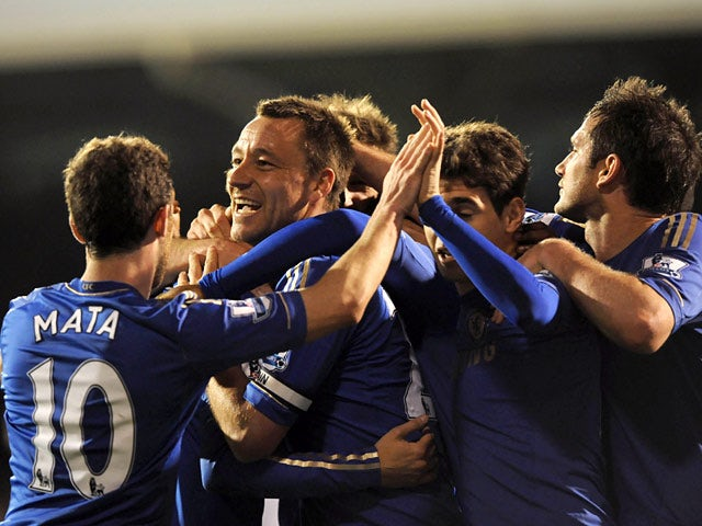 Chelsea's John Terry celebrates with team mates after scoring his team's second goal against Fulham during the Premier League match on April 17, 2013