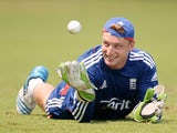 Jos Buttler of England takes part in a wicketkeeping drill during a nets session at Sir Viv Richards Cricket Ground on February 24, 2014