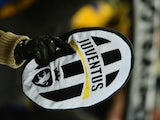 A Juventus supporter waves their logo during the Italian Serie A football match between Juventus and Fiorentina at the Juventus Stadium in Turin on February 9, 2013