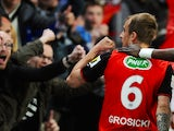 Rennes' Polish forward Kamil Grosicki celebrates after scoring a goal during the French cup semifinal football match between Rennes and Angers on April 15, 2014