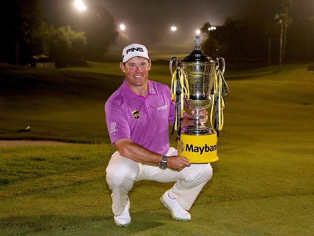 Lee Westwood poses with the trophy after winning the final round at the Maybank Malaysian Open on April 19, 2014