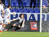 Cagliari's Marco Sau scores his team's first goal against Genoa during the Serie A match on April 19, 2014