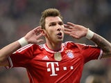 Bayern's Mario Mandzukic celebrates after scoring his team's third goal against Kaiserslautern during the DFB-Pokal semi-final match on April 16, 2014