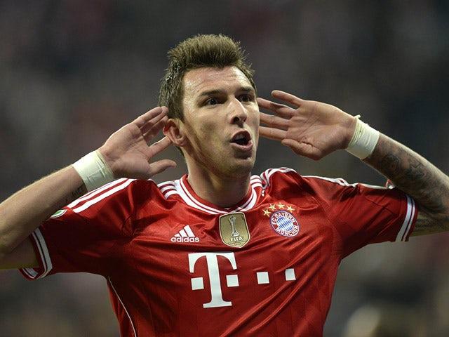 Bayern's Mario Mandzukic celebrates after scoring his team's third goal against Kaiserslautern during the DFB-Pokal semi-final match on April 16, 2014