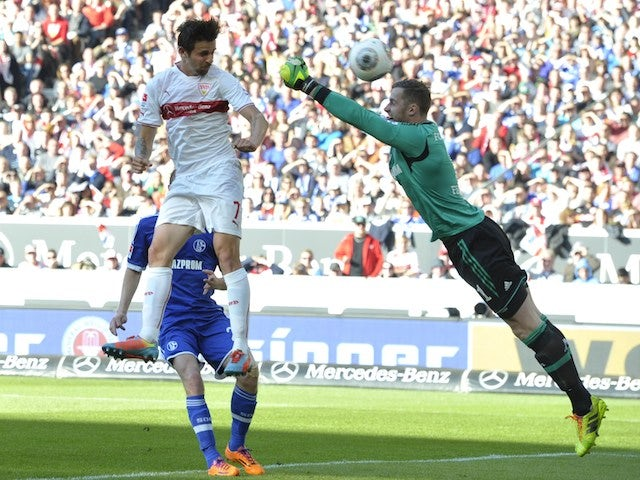 Stuttgart's Austrian forward Martin Harnik (L) scores the opening goal past Schalke's goalkeeper Ralf Faehrmann during the German first division Bundesliga football match on April 20, 2014