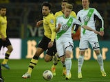 Dortmund's defender Mats Hummels (L) and Wolfsburg's Belgian midfielder Kevin De Bruyne vie for the ball during the German Cup (DFB Pokal) semi-final football match on April 15, 2014