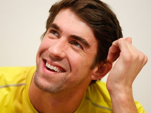 Phelps drops out of comeback event