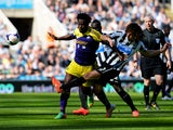 Wilfried Bony of Swansea City is tackled by Fabrizio Coloccini of Newcastle United during the Barclays Premier League match between Newcastle United and Swansea City at St James' Park on April 19, 2014