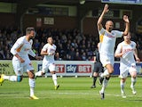 Chris Zebroski of Newport County celebrates scoring the first goal during the Sky Bet League Two match between AFC Wimbledon and Newport County at The Cherry Red Records Stadium on April 18, 2014