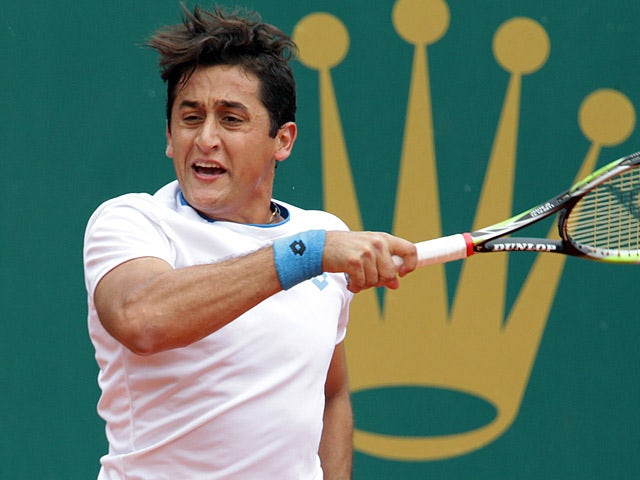 Nicolas Almagro in action against Nicolas Mahut during the Monte Carlo Masters second round on April 16, 2014