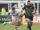 Luther Burrell of Northampton breaks with the ball during the Aviva Premiership match between Northampton Saints and London Irish at Franklin's Gardens on April 20, 2014