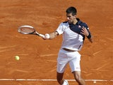 Serbia's Novak Djokovic returns the ball to Spain's Pablo Carreno Busta during their Monte-Carlo ATP Masters Series Tournament tennis match, on April 17, 2014