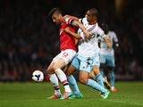 Olivier Giroud of Arsenal battles with Winston Reid of West Ham United during the Barclays Premier League match on April 15, 2014