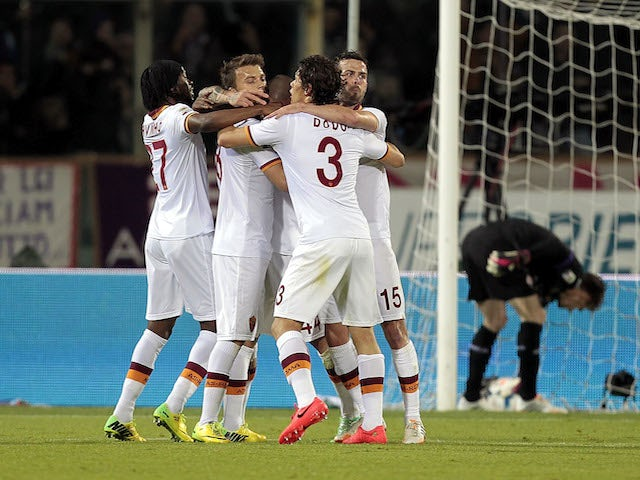 Roma players celebrate a goal scored by Radja Nainggolan during the Serie A match between ACF Fiorentina and AS Roma at Stadio Artemio Franchi on April 19, 2014