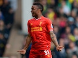 Liverpool's Raheen Sterling celebrates after scoring the opening goal against Norwich during the Premier League match on April 20, 2014