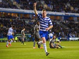 Alex Pearce of Reading celebrates scoring to make it 1-0 during the Sky Bet Championship match between Reading and Leicester City at the Madejski Stadium on April 14, 2014