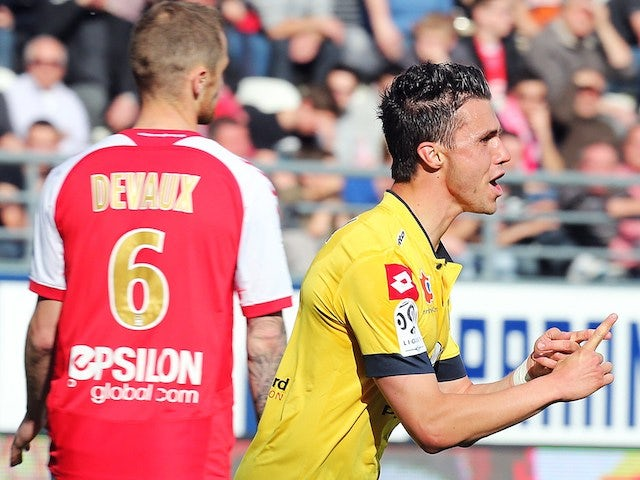 Sochaux' French defender Sebastien Corchia (R) celebrates after scoring a goal during the French Ligue 1 football match between Stade de Reims and FC Sochaux-Montb�liard (FCSM), on April 2014