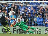 David Marshall the goalkeeper of Cardiff City dives the wrong way as Marko Arnautovic of Stoke City scores the opening goal from a penalty during the Barclays Premier League match between Cardiff City and Stoke City at the Cardiff City Stadium on April 19