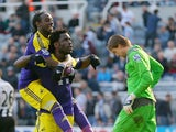 Wilfried Bony of Swansea City celebrates with Marvin Emnes of Swansea City after scoring against past Tim Krul of Newcastle United during the Barclays Premier League fixture between Newcastle United and Swansea City at St. James Park on April 19, 2014