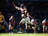 London Wasps' Tom Varndell goes on to score a try against Gloucester during the Aviva Premiership match on April 19, 2014