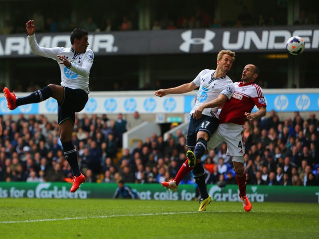 Harry Kane of Tottenham Hotspur scores their second goal during the Barclays Premier League match between Tottenham Hotspur and Fulham at White Hart Lane on April 19, 2014