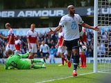 Younes Kaboul of Tottenham Hotspur celebrates scoring their third goal during the Barclays Premier League match between Tottenham Hotspur and Fulham at White Hart Lane on April 19, 2014