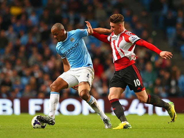 Sunderland's Connor Wickham and Manchester City's Vincent Kompany in action during the Premier League match on April 16, 2014