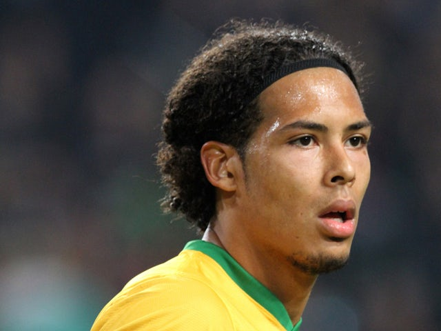 Virgil van Dijk of Celtic FC in action during the UEFA Champion League group stage match between AFC Ajax and Celtic FC held on November 6, 2013