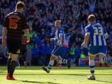 Callum McManaman of Wigan Athletic celebrates scoring his team's third goal during the Sky Bet Championship match between Wigan Athletic and Reading at DW Stadium on April 18, 2014
