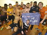 Wolverhampton Wanderers players celebrate their promotion to the Championship on April 12, 2014
