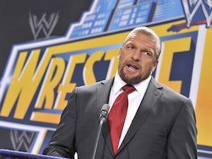 John Terry lifts custom-made WWE belt