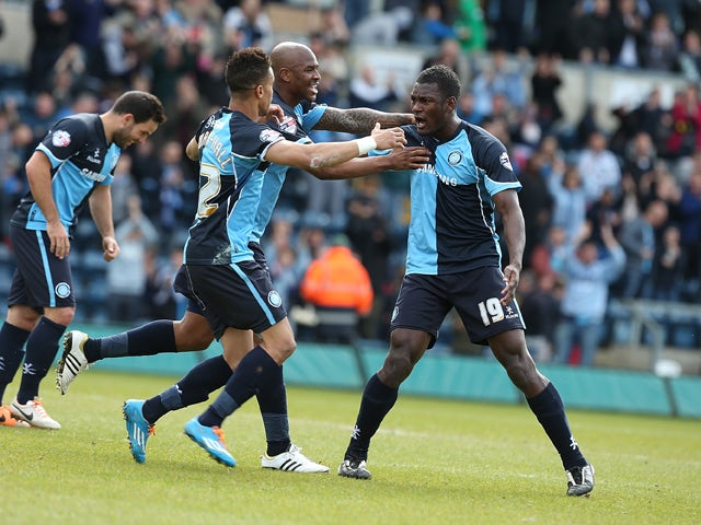 Aaron Pierre of Wycombe Wanderers celebrates with team mates after scoring his sides 1st goal during the Sky Bet League Two match between Wycombe Wanderers and Northampton Town at Adams Park on April 18, 2014