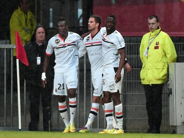 Lorient's French midfielder Alain Traore (L) celebrates with teammates after scoring a goal during the French L1 football match against Rennes on April 26, 2014