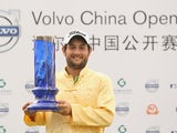 Alexander Levy celebrates with the trophy after winning the 2014 Volvo China Open on April 27, 2014