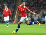 Barcelona's Alexis Sanchez celebrates scoring for Chile against England on November 15, 2013.