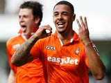 Andre Gray of Luton Town celebrates after scoring his second goal during the Skrill Conference Premier match against Forest Green on April 21, 2014