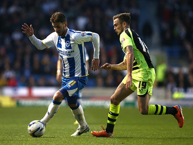 Brighton's Andrea Orlandi and Yeovil's Joe Ralls in action during the Championship match on April 25, 2014