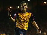 Andrey Arshavin, then of Arsenal, celebrates his fourth goal against Liverpool on April 21, 2009.