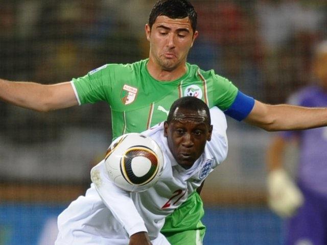 Algeria's Antar Yahia challenges England's Emile Heskey on June 18, 2010.