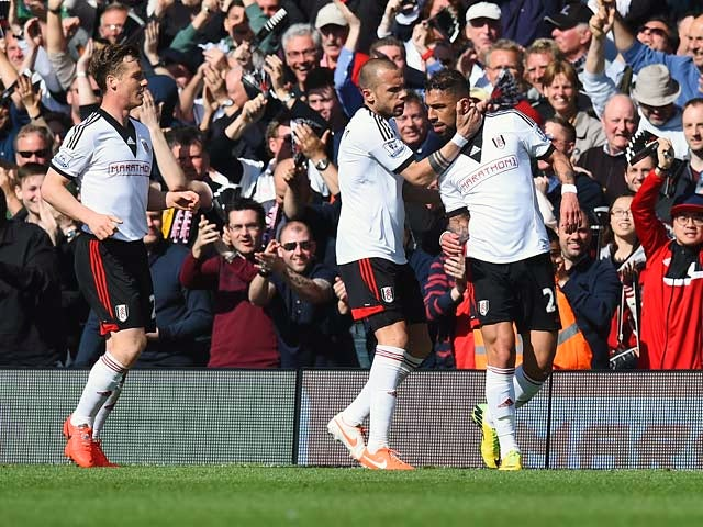 Fulham's Ashkan Dejagah celebrates with teammates after scoring the opening goal against Hull during the Premier League match on April 26, 2014