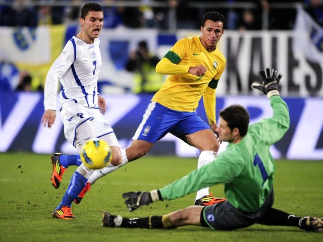 Bosnia goalkeeper Asmir Begovic makes a save against Brazil on February 28, 2012.