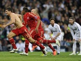 Bayern Munich's striker Mario Gomez (L) and Bayern players run as they celebrate after winning the UEFA Champions League second leg semi-final football match on April 25, 2012