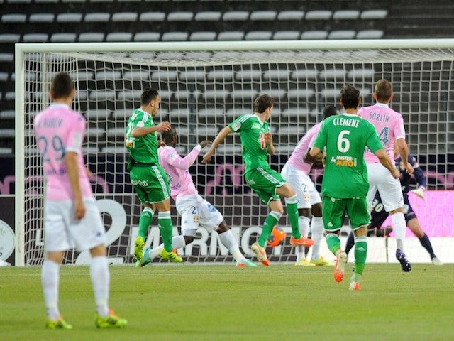 St Etienne's French midfielder Benjamin Corgnet (C) shoots and scores a goal during the French L1 football match between Evian (ETGFC) and Saint-Etienne (ASSE) on April 26, 2014