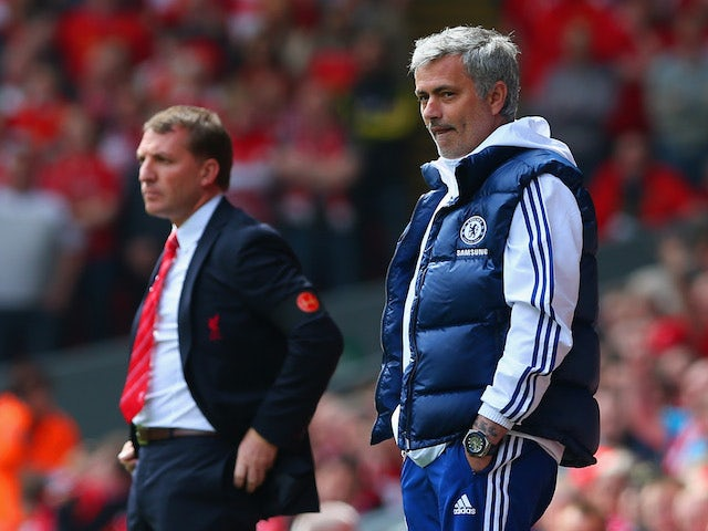 Manager Brendan Rodgers of Liverpool and Jose Mourinho manager of Chelsea look on from the touchline during the Barclays Premier League match on April 27, 2014