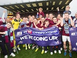 Burnley players celebrate promotion to the Premier League on April 21, 2014