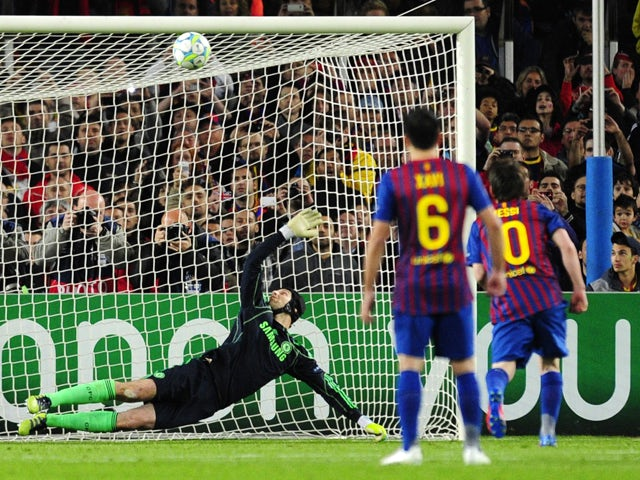 Barcelona's Argentinian forward Lionel Messi misses a penalty shot against Chelsea's Czech goalkeeper Petr Cech during the UEFA Champions League second leg semi-final football match Barcelona against Chelsea at the Cam Nou stadium in Barcelona on April 24