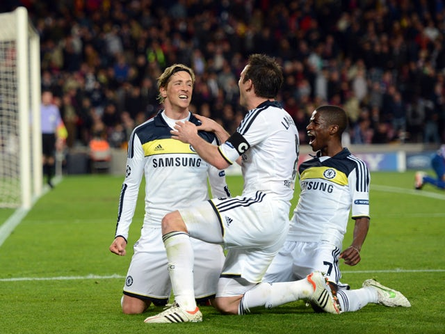 Chelsea's Spanish forward Fernando Torres celebrates with teammates midfielder Frank Lampard and Brazilian midfielder Ramires after scoring during the UEFA Champions League second leg semi-final football match Barcelona against Chelsea at the Cam Nou stad