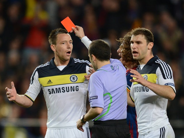 Chelsea's defender John Terry receives a red card from Turkish referee Cuneyt Cakir during the UEFA Champions League second leg semi-final football match Barcelona against Chelsea at the Cam Nou stadium in Barcelona on April 24, 2012